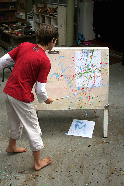 Young boy's splatter artwork stock photo