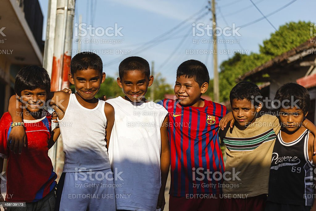 Young boys street soccer team poses for photo stock photo