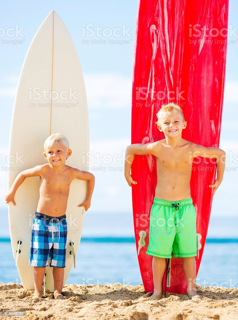 Young Boys with Surfboards stock photo