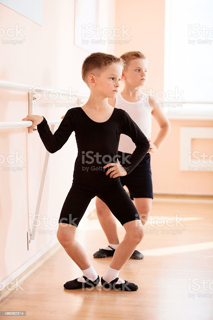 Young boys working at the barre stock photo