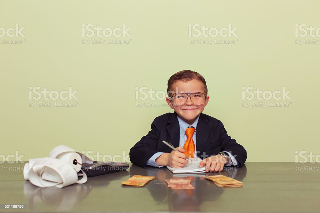Young Brazilian Boy Accountant with Money stock photo