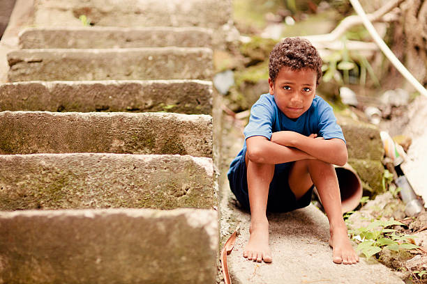 Young Brazilian Boy Portrait of a young boy from a Rio de Janeiro, Brazil  favela. illiteracy stock pictures, royalty-free photos & images