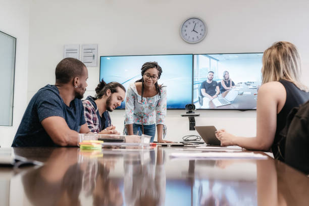 young brazilian business people in meeting room stock photo