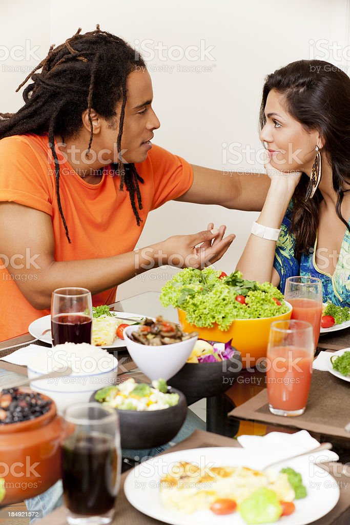 Young Brazilian couple talking over lunch royalty-free stock photo