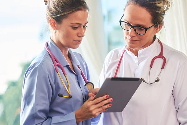 young brazilian doctor and nurse with tablet - assistant stock pictures, royalty-free photos & images