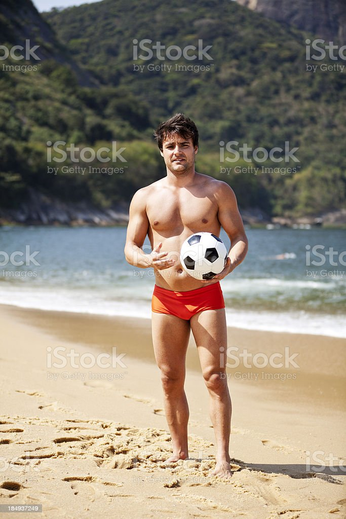 Young brazilian man at the beach with soccer ball royalty-free stock photo