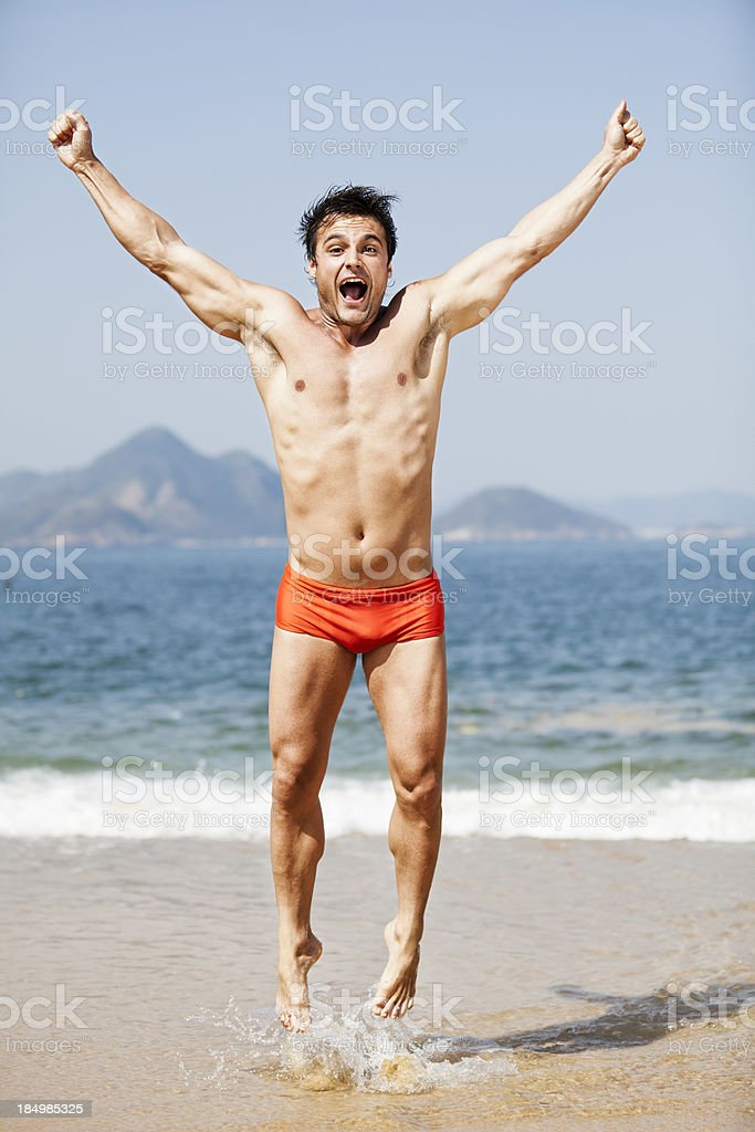 Young brazilian man jumping on the beach royalty-free stock photo
