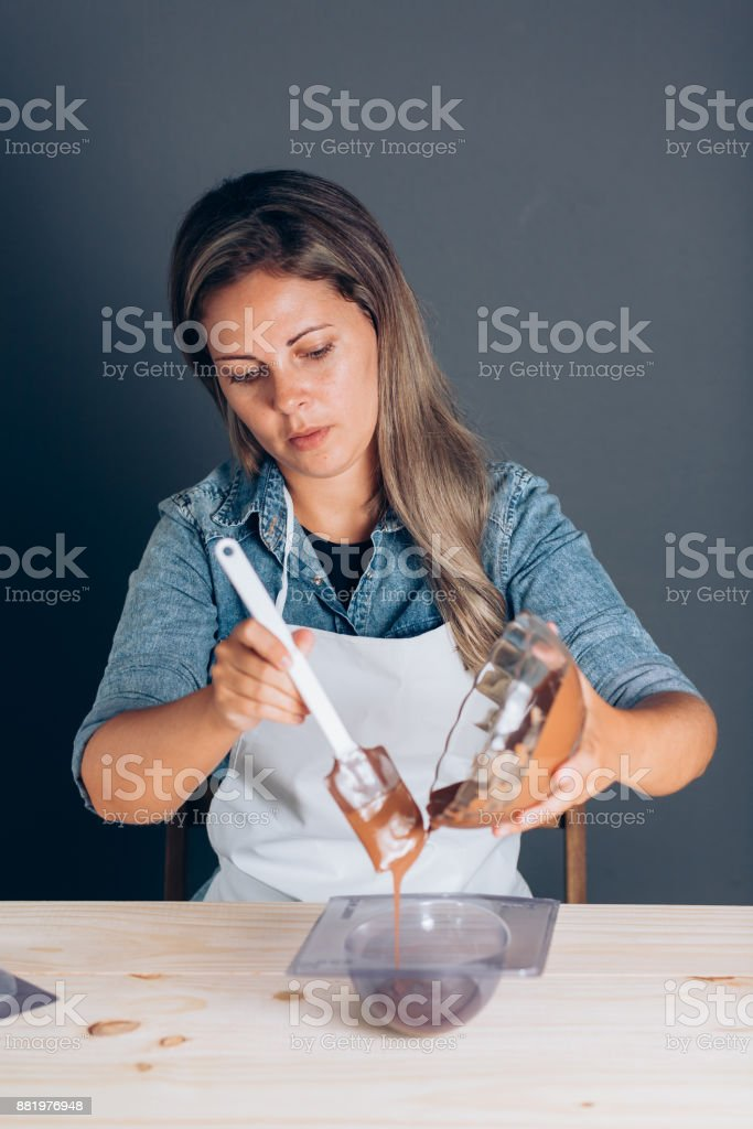 Young Brazilian woman making homemade Easter eggs stock photo