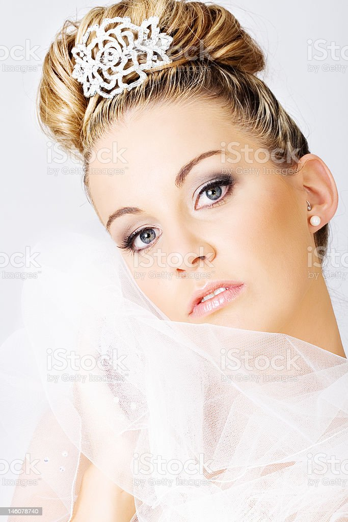 Young bride holding a veil royalty-free stock photo