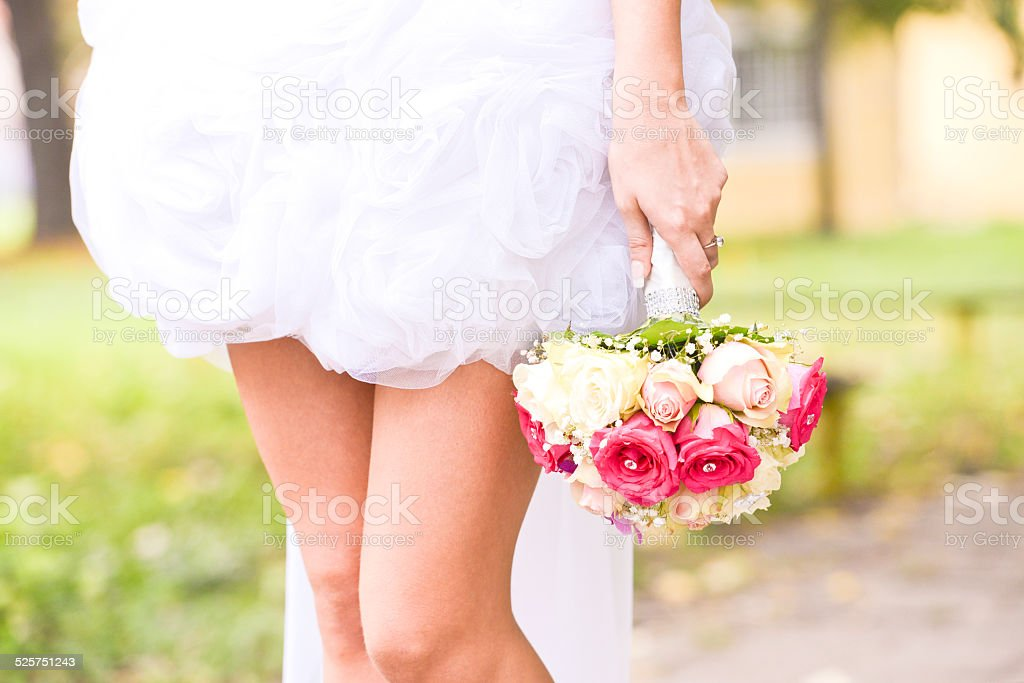 Young bride holding bouquet stock photo