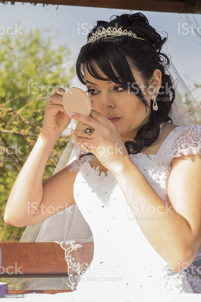 young bride is doing makeup royalty-free stock photo