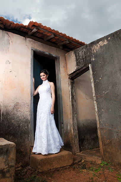 Young Bride Posing Outside Old Country House Door - foto de acervo