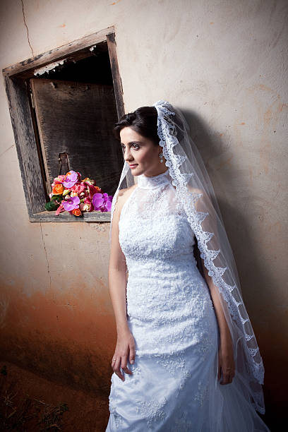 Young Bride Posing Outside Old Country House Window and Bouquet - foto de acervo