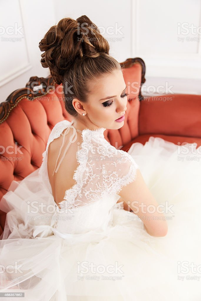 young bride sitting on the couch royalty-free stock photo