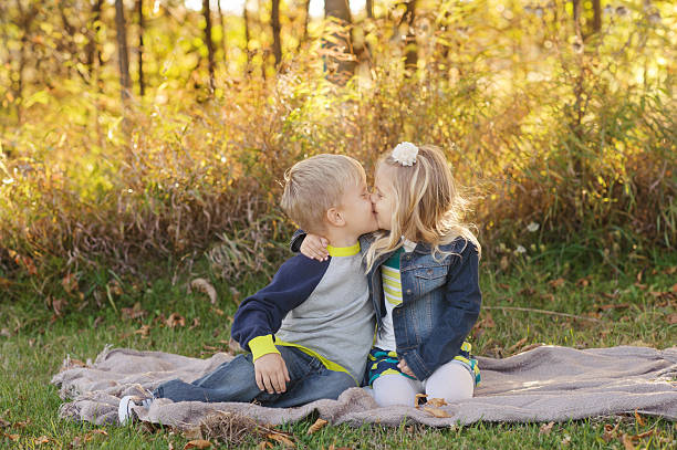 young brother and sister - little girls little boys kissing love stock photos and pictures