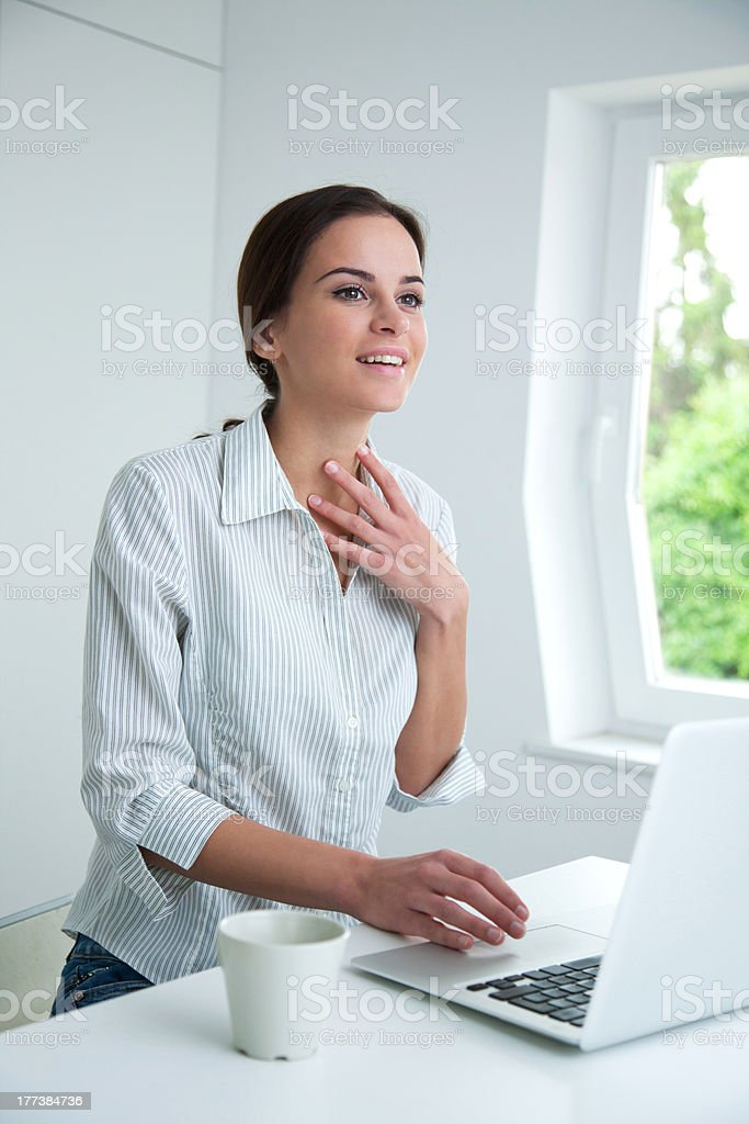 Young brunette businesswoman with laptop stock photo