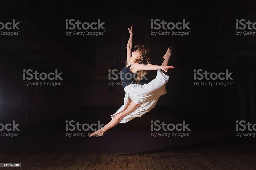 Young brunette dancer girl in split jump stock photo