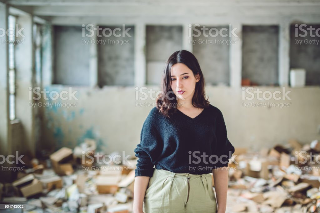 Young brunette in an abandoned building royalty-free stock photo