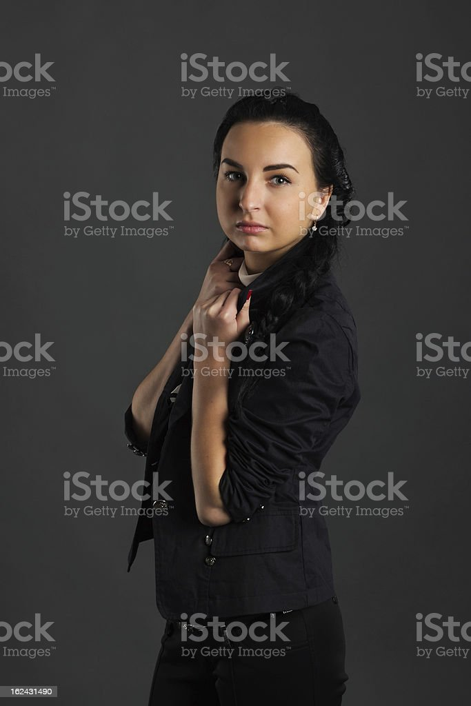 Young brunette in dark clothing royalty-free stock photo