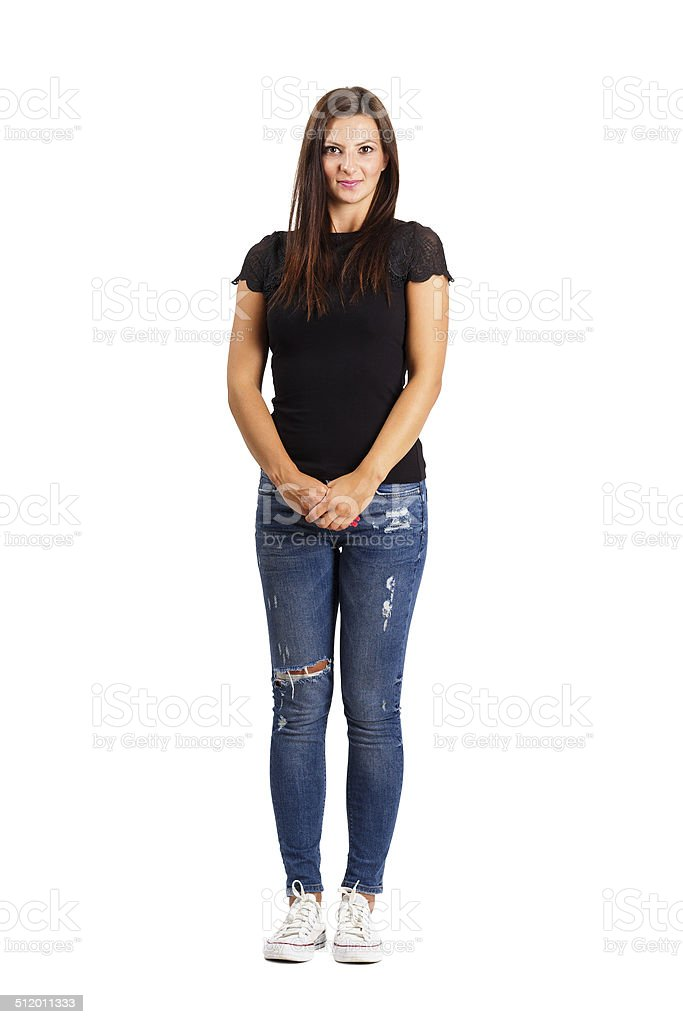 Young brunette in modern casual clothes holding her hands. stock photo