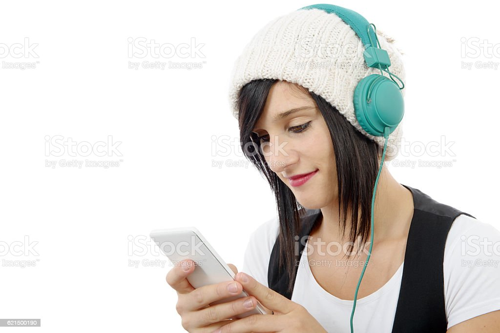 young brunette listening to music with headphones and  phone Lizenzfreies stock-foto