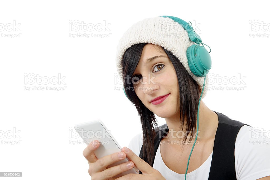 young brunette listening to music with headphones and  phone photo libre de droits