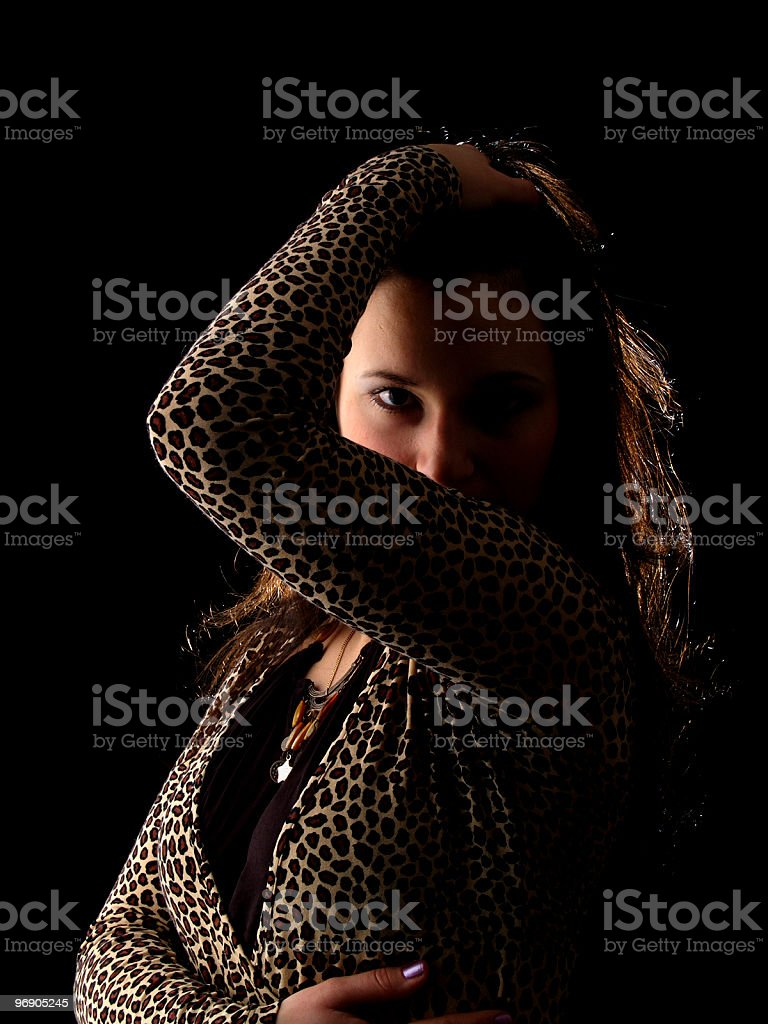 Young brunette on black royalty-free stock photo