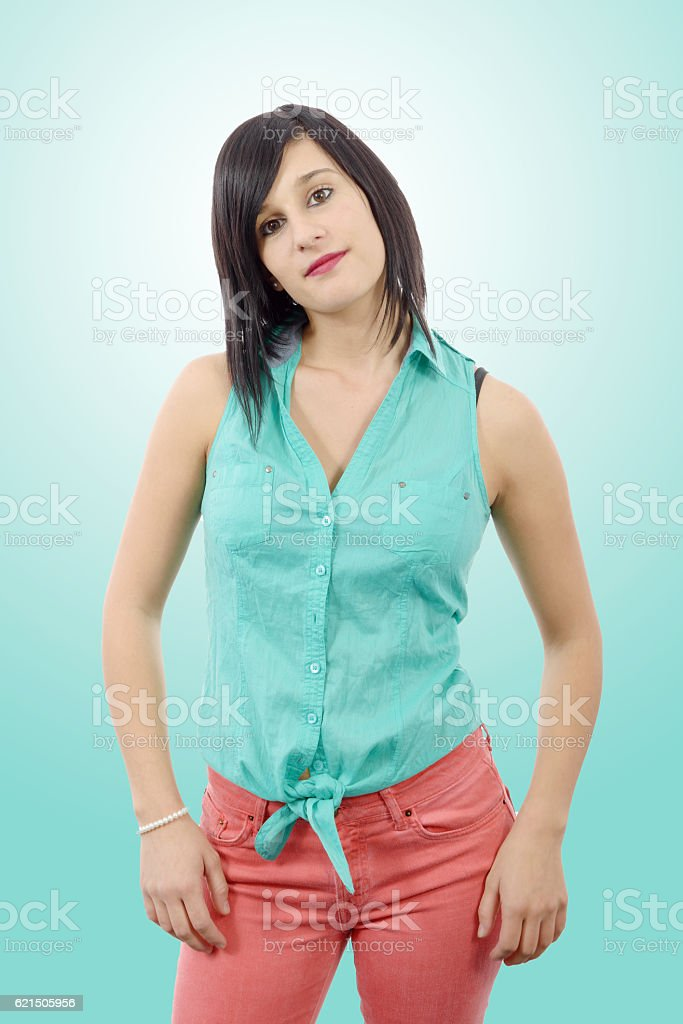 young brunette with a green shirt and pink pants foto stock royalty-free