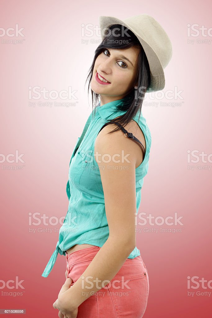 young brunette with a green shirt and pink pants Lizenzfreies stock-foto