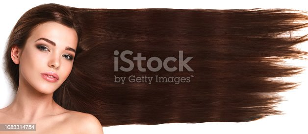 Young brunette with long and healthy hair on white background