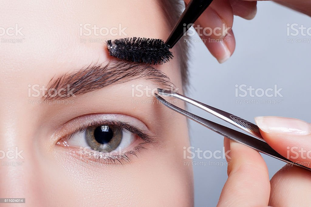 young brunette with short hair woman make-up. girl Cosmetic. stock photo