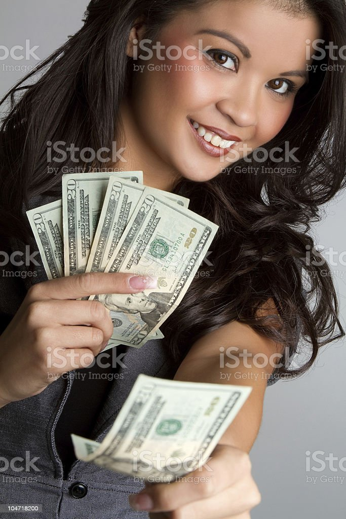 Young brunette woman holding money royalty-free stock photo