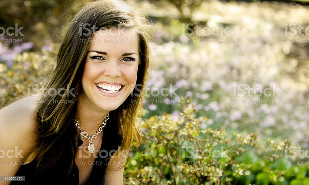 Young brunette woman outside in a field royalty-free stock photo