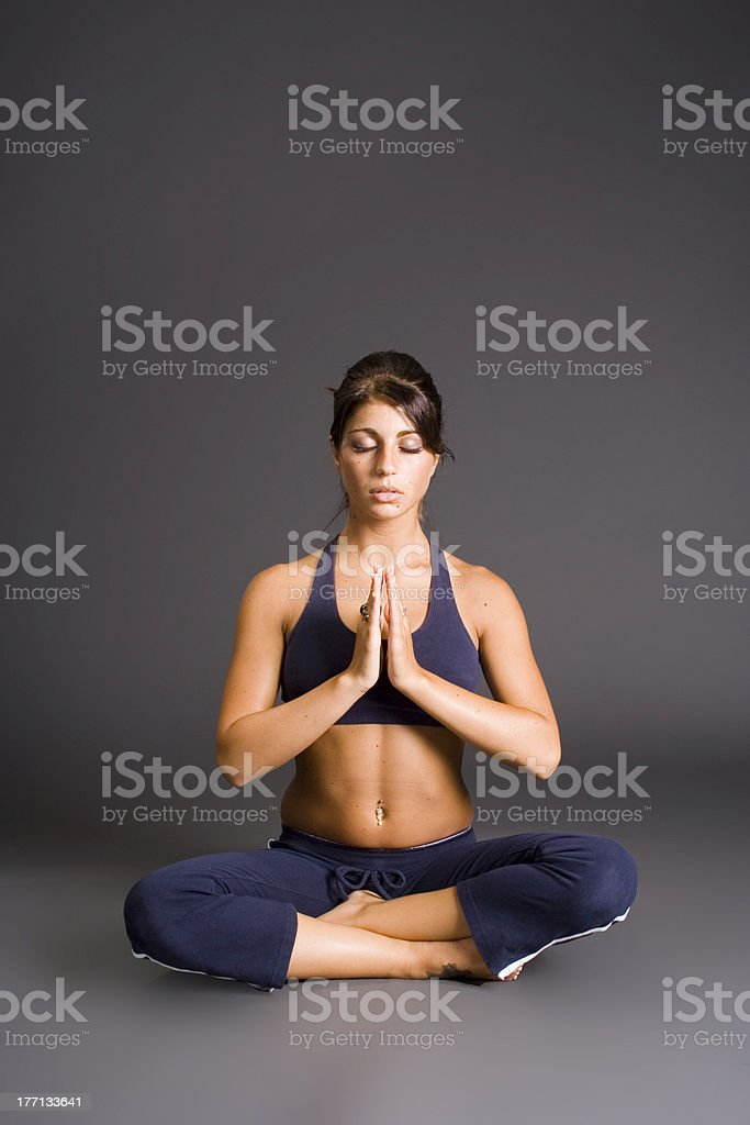 Young brunette woman practicing yoga poses stock photo