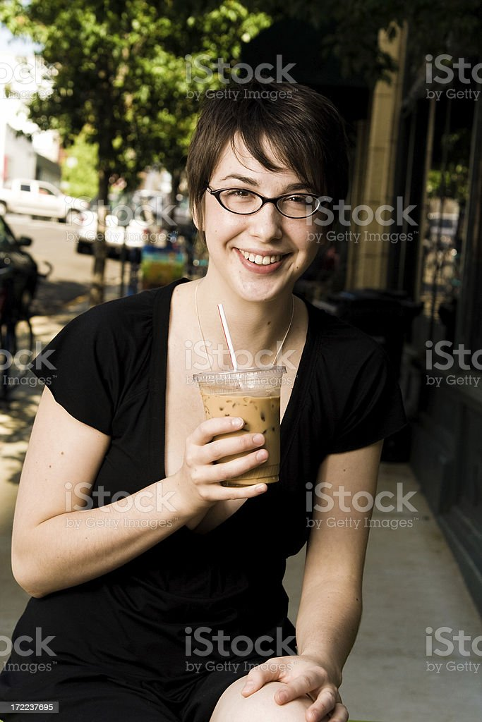 young brunette woman with an iced coffee downtown royalty-free stock photo