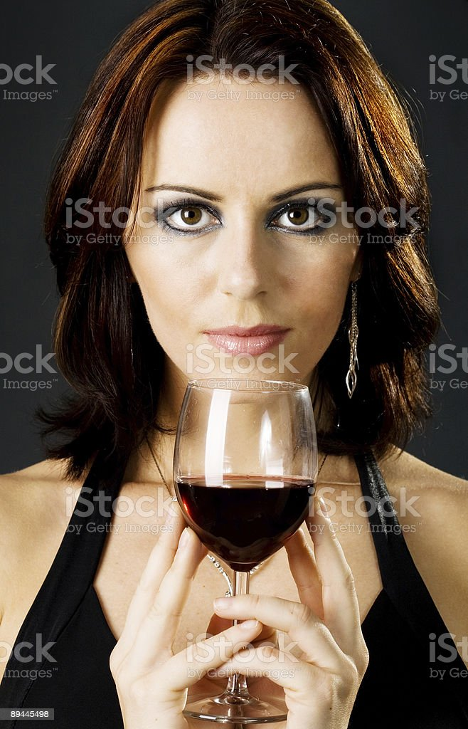 Young brunnete celebrating royalty-free stock photo