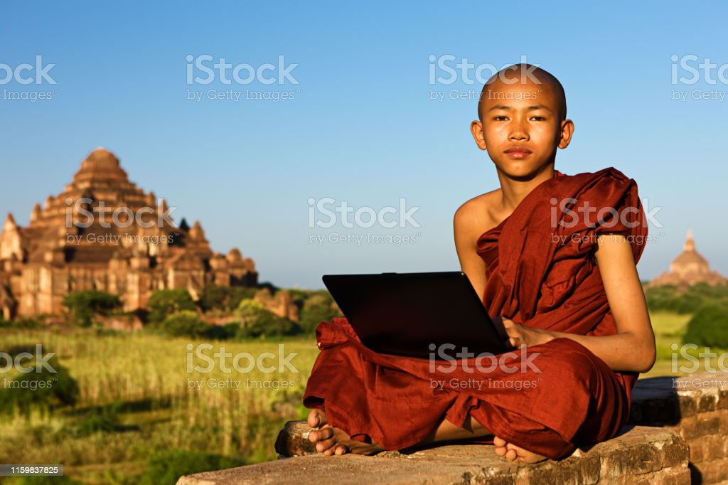 Young Buddhist monk using a laptop, Bagan, Myanmar