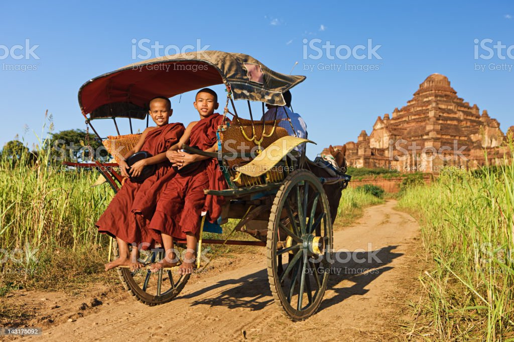 Young Buddhist monks on the horse cart royalty-free stock photo