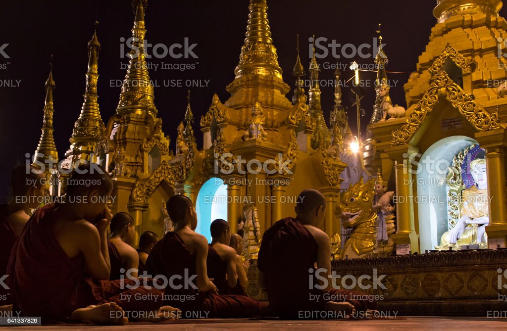 Young Buddhists praying in Shwedagon Pagoda, Myanmar stock photo