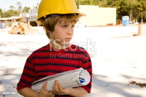 istock Young builder with blueprints and hardhat 93987962