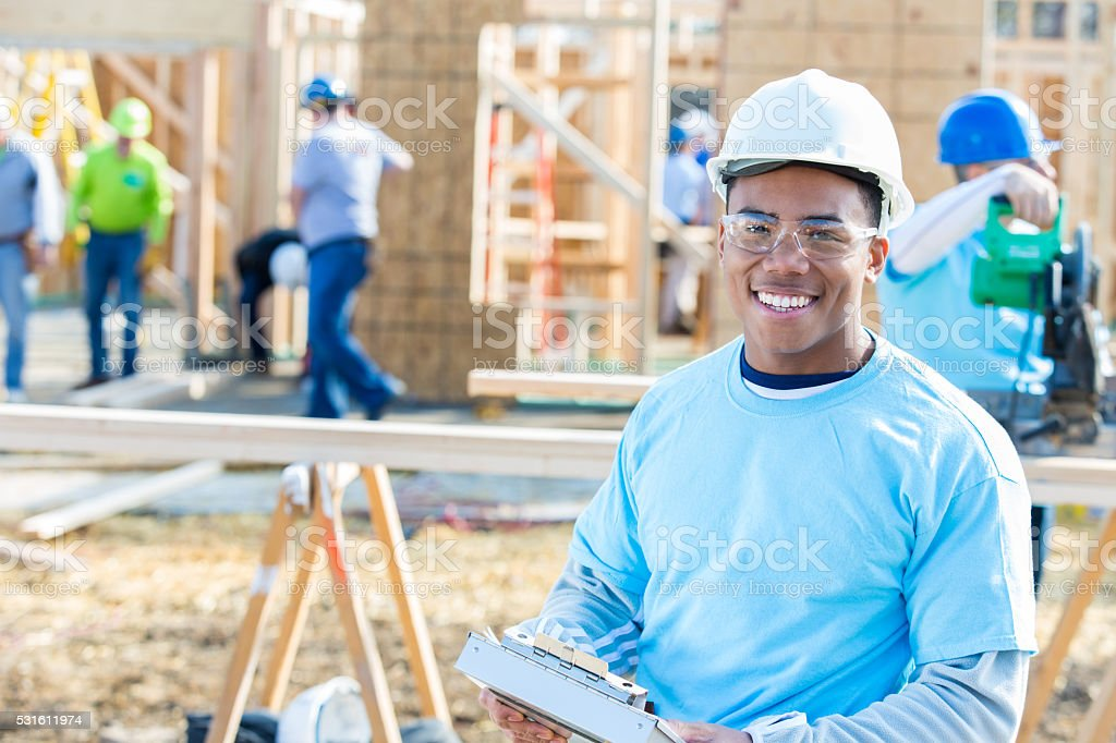 Young building foremanat new home construction site stock photo