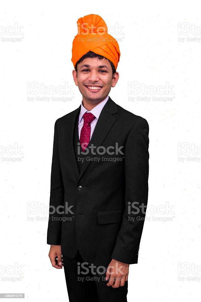 Young busines man getting ready for an Indian ceremony. stock photo