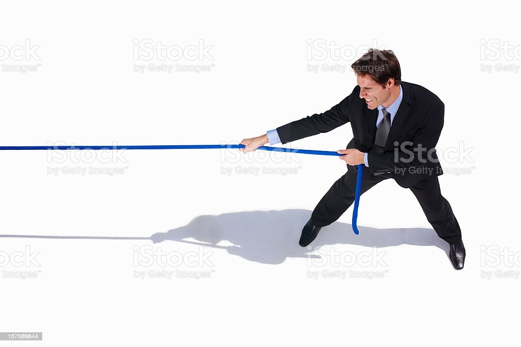 Young business adult pulling a rope on white royalty-free stock photo