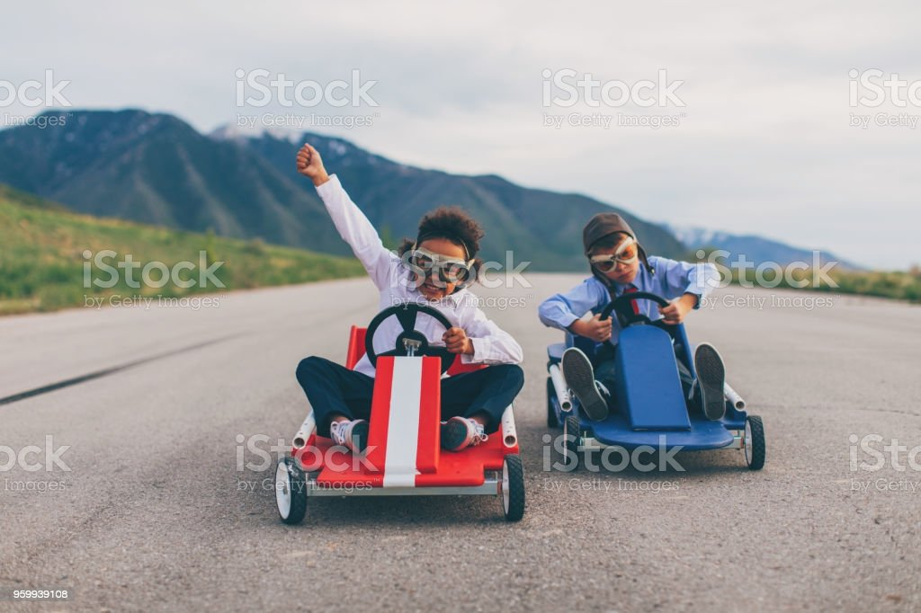 Young Business Boy and Girl Race Cars stock photo