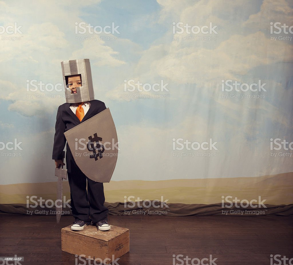 Young Business Boy Dressed as Knight stock photo