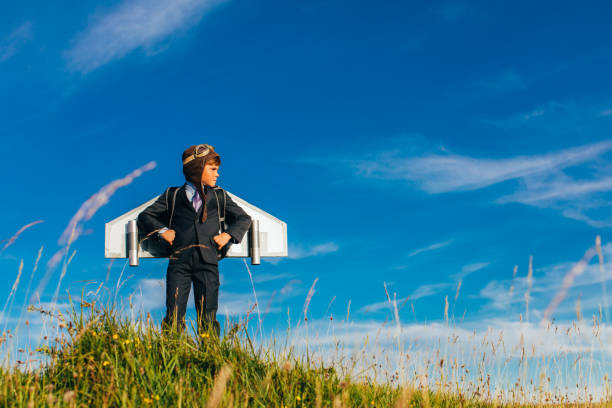 Young Business Boy Entrepreneur Wearing Jetpack stock photo