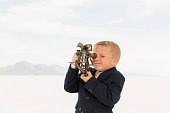 istock Young Business Boy Looking Through Sextant 503782010