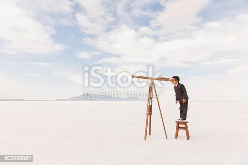 Young Business Boy Looking Through Telescope stock photo ...