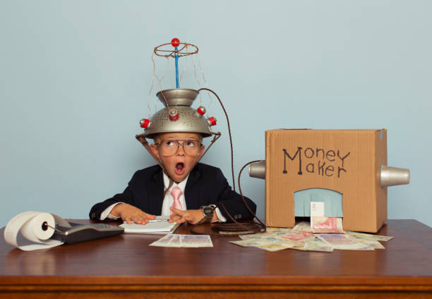 young business boy making pound sterling - genius stock photos and pictures