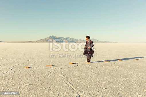 istock Young Business Boy On Stepping Stones 844638626